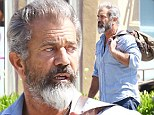 On a fitness mission? Mel Gibson displays his growing biceps as he strides into a Los Angeles gym