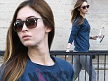 Megan Fox goes make-up free and displays her impressive post-pregnancy body in grey tights while out with husband Brian Austin Green