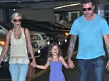 Tori Spelling looks slender in sleeveless tank top as it's revealed 'cameras rolled inside hospital where she was treated for an ulcer and severe migraines'