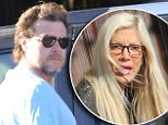 Stepping in? Dean McDermott takes son Liam to school after distressed wife Tori Spelling stays at home following release from hospital