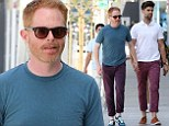 They're a match! Jesse Tyler Ferguson and husband Justin Mikita sport similar coloured trousers while holding hands on a weekend stroll