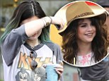 Not ready to Kiss and makeup: Kylie Jenner hides face as she rocks vintage T-shirt... while it's revealed 'she wants nothing to do with Selena Gomez'
