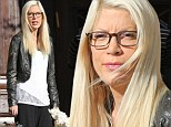 Tori Spelling spotted for first time since leaving hospital after 'secret six day stay'... and she's already back to work on reality TV show documenting her marriage troubles