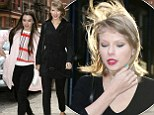 Gone with the wind! Taylor Swift's perfect hair gets messed up by sudden gust as she showcases her physique in all-black ensemble