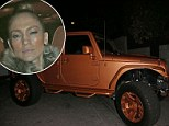 Jennifer Lopez sports a steely expression as she attempts to make a low-key exit from date night... in beau Casper Smart's new GIANT ORANGE car