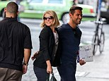 Loved up couple: Kelly Ripa and Mark Consuelos couldn't keep their hands off each other while out and about in New York City on Monday