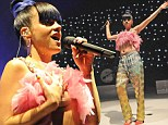 Lily Allen suffers nip-slip in bizarre flamingo-pink crop top and glitter jogging pants as she launches new album