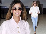 English rose: Cheryl Cole turns heads in a pink bomber jacket as she arrives in LA