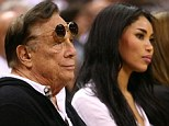 Damning recording: Donald Sterling (center) can be heard telling his girlfriend V. Stiviano (to his right) not to bring black people to Clippers games