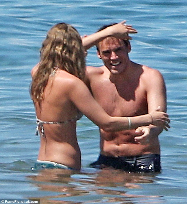 Oo-er: The couple had a playful tustle in the water as they enjoyed their time off together