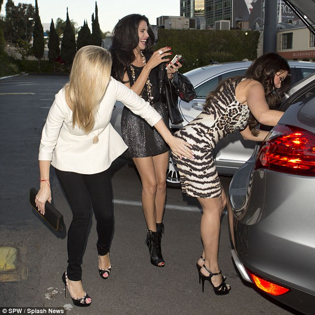 Cheeky lady: As her former co-star Karent lent into the back of her car, Joanna playfully spanked the dentist on her rear end