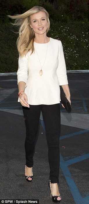 Simply sexy: The 35-year-old looked chic and sexy in a pair of tight black pants with a tasteful three-quarter sleeve white top which had a peplum bottom