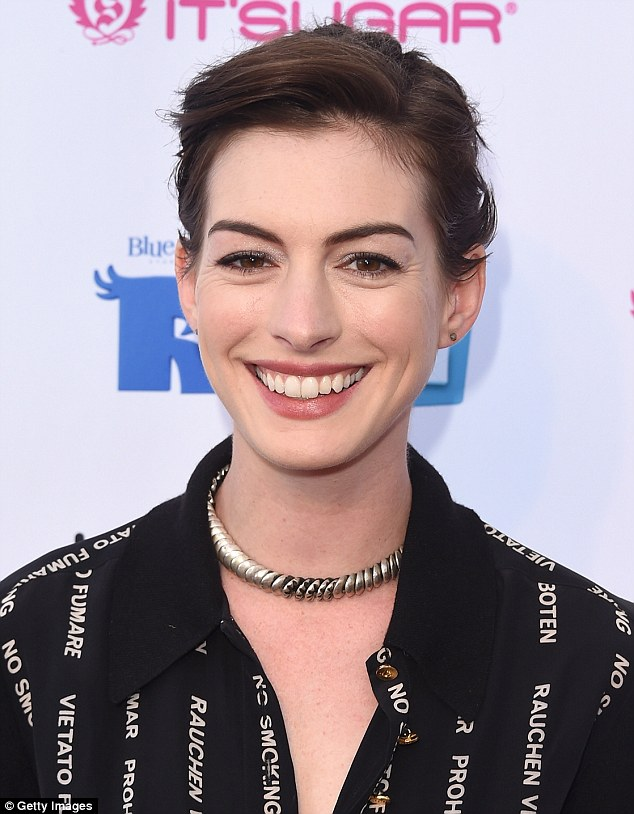 Health-conscious: Anne Hathaway wore an anti-smoking blouse to a screening on Night Under The Stars in LA on Saturday
