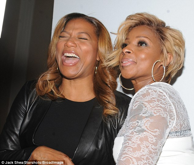 What's so funny? There was certainly some sort of joke going around that made Queen Latifah crack up