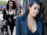 Kim Kardashian distracts attention from her famous derriere as she goes braless in plunging cleavage-baring top