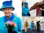 Queen holds a posy of flowers