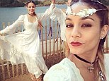 My faire lady! Vanessa Hudgens dons white maiden's dress and braids while at a Renaissance festival with a friend