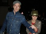 He's a true gentleman: Damian Lewis scoops up his wife Helen McCrory's scooter so they can walk hand-in-hand after romantic date
