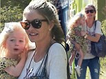 A right little handful! Rebecca Gayheart carries daughter Billie back to the car after outing in Los Angeles
