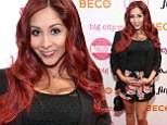 To be continued! Snooki takes to the red carpet with her barely-there bump