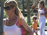Denise Richard goes for a walk in all white with daughter Eloise