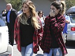 Taking style tips from Khloe? While the older sister often wears her plaid shirt, it appears as if Kylie has been influenced by her style