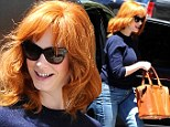 Red hot! Christina Hendricks matches her fiery auburn locks with leather purse while out an about in Los Angeles