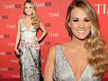 Carrie Underwood dazzles in plunging floral frock as she is honoured at TIME's 'Most Influential People In The World' gala