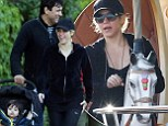 Baby's day out! Shakira and her son Milan ride a merry-go-round as she goes makeup-free for family time