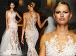 Karolina Kurkova captivates the catwalk in sheer lace gown as she models an array of wedding wear during Barcelona Bridal Week