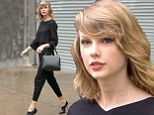 Not her usual colourful self: Taylor Swift went for head to toe black while out in New York on Friday