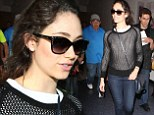 Calm and collected! Emmy Rossum maintains poise while sporting a netted black sweater at LAX