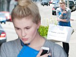 Ireland Baldwin steps out for first time since THOSE Angel Haze kissing pics to shop at Marc Jacobs