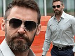 Hugh Jackman looks glum as he steps out with Band-Aid on nose after revealing second cancer operation