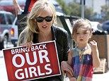 Now Kimberly Stewart joins the Bring Back Our Girls campaign as she protests with daughter Delilah and Penny Lancaster