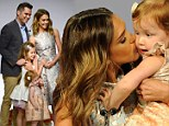 A shining example! Jessica Alba kisses her daughters and husband as she is named Mother Of The Year... while looking amazing in metallic dress