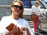 Cameron Diaz shows off her slender frame in loose white top and skinny jeans as she runs errands in LA