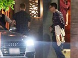 Entourage: Singer's unidentified male friends first checked for paparazzi before walking out to a silver Audi waiting for them outside