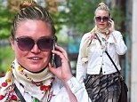 Not your best look... Julia Stiles donned an unflattering ensemble as she stepped out in New York City on Friday