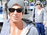 Taking it too far? Mickey Rourke showed no signs of slowing down as he revealed an even leaner frame after hitting Equinox Gym in West Hollywood on Friday