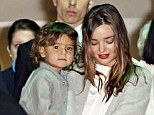 Quite a welcome home party: Miranda Kerr, 31, was met by her three-year-old son Flynn and parents as she arrived at Sydney Airport on Saturday night