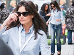 Busy mom: 35-year-old actress Katie Holmes appeared to be in a hurry as she dropped her daughter Suri off at school
