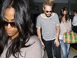 Bumpy ride, was it? Zoe Saldana and Marco Perego look dishevelled as they land in LA... a day after actress admitted she's a member of the Mile High Club