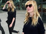 She's On The Road again! Kirsten Dunst goes make-up free as she jets into London in chunky black jumper and skinny jeans