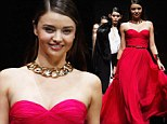 Miranda Kerr is a vision in fuchsia as she floats down the catwalk in strapless gown at fashion show in Shanghai