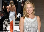 Ali Larter shows off toned back in flowing white gown as she makes elegant entrance at boudoir store opening