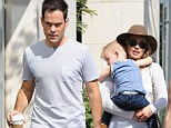 Still tight: Hilary Duff and her estranged husband Mike Comrie stepped out for breakfast with their two-year-old son Luca in Los Angeles on Saturday