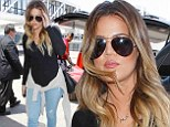 Lean: Khloe Kardashian showed off her toned legs as she jetted out of Los Angles International Airport on Saturday