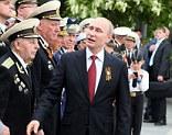President Vladimir Putin (centre) meets Second World War veterans and Russian servicemen during his visit to Sebastopol, Crimea on Friday