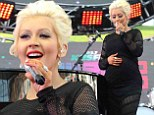 Pregnant Christina Aguilera proudly shows off baby bump in tight black dress as she takes stage at Wango Tango